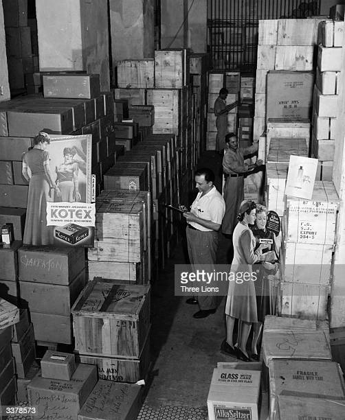 A warehouse containing stacks of crated goods and advertising displays in Puerto Rico