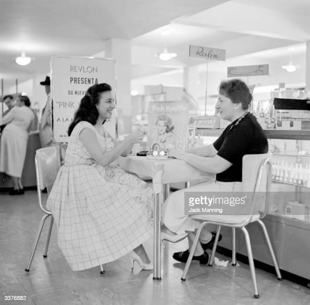 A woman receiving a cosmetic consultation in Sears Roebuck department store Caracas Venezuela
