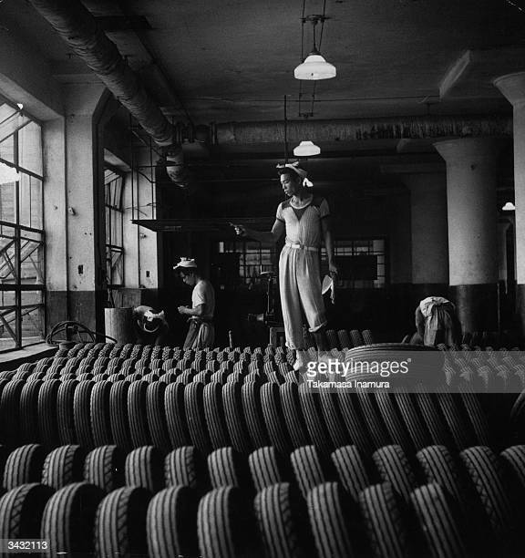 Worker counting tyres at the Bridgestone Tire factory on the Japanese island of Kyushu.