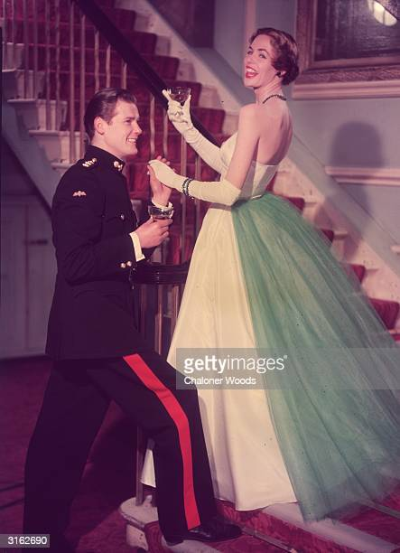 Young Roger Moore poses as a military man meeting his lovely date for a night on the town.