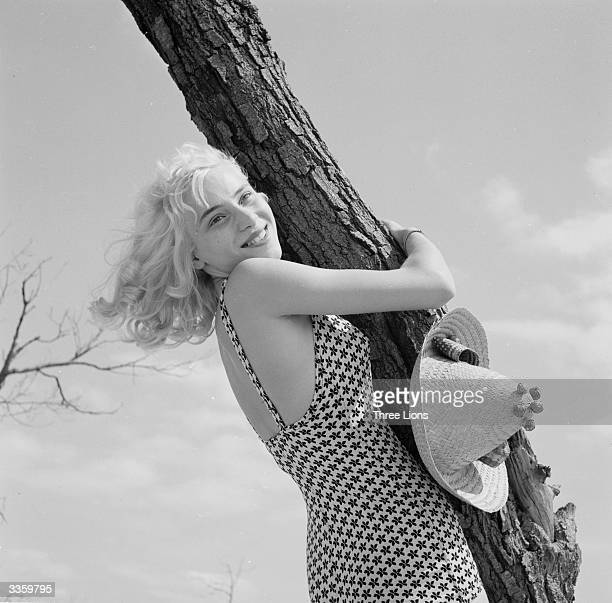 A young woman hugging a tree near West Beach Michigan City Indiana