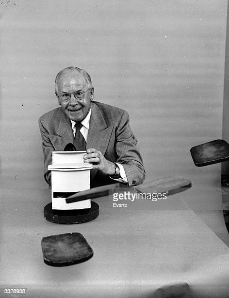 Amateur American inventor Russell E Oakes posing with his 'pop at you' toaster which ejects toast forcefully and horizontally