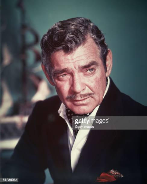 Circa 1955, American actor Clark Gable wears a polka-dot ascot in an unidentified promotional film still, 1950s.