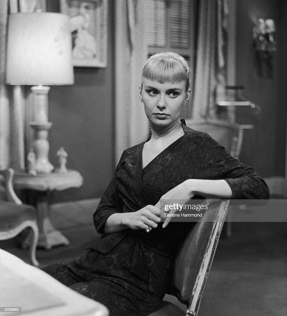 American actor Joanne Woodward sits on the set of the CBS-TV show, 'Playhouse 90'.