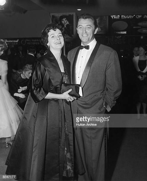 American actor Robert Mitchum and his wife Dorothy pose together at a formal party Hollywood California Mitchum wears a tuxedo