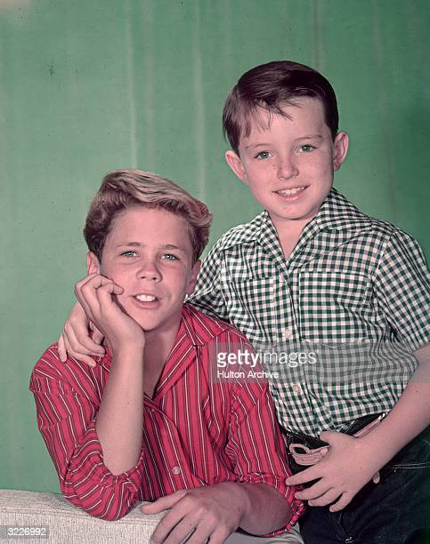 American actors Tony Dow and Jerry Mathers pose together in a promotional portrait for the television show 'Leave It to Beaver'