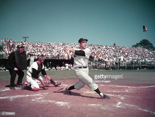Circa 1955 American baseball player Yogi Berra catcher for for the New York Yankees swinging the bat during a game 1950s
