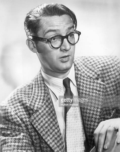 American comedian and songwriter Steve Allen makes a face in a promotional portrait for the television program 'Songs for Sale'