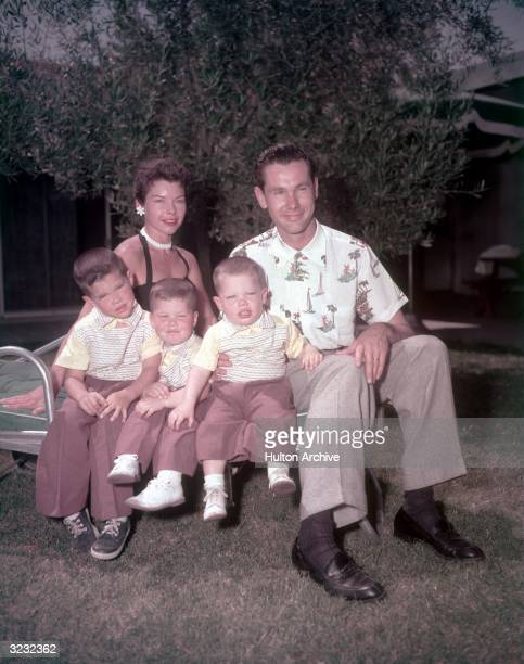 American comedian and television host Johnny Carson and his wife Jody Wolcott pose with their three sons Christopher Richard and Cory in the back...