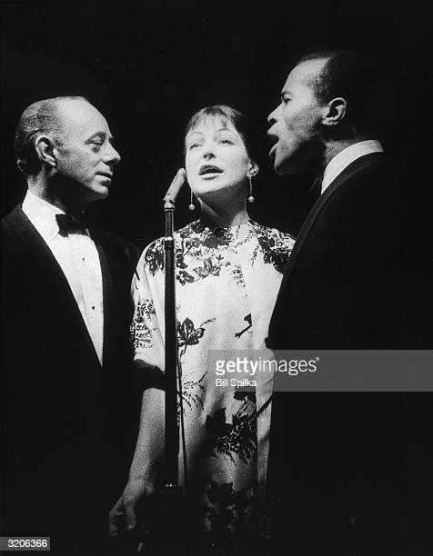 American jazz vocal group Lambert Hendricks Ross performing in front of a microphone on stage during a concert LR Dave Lambert Annie Ross and Jon...