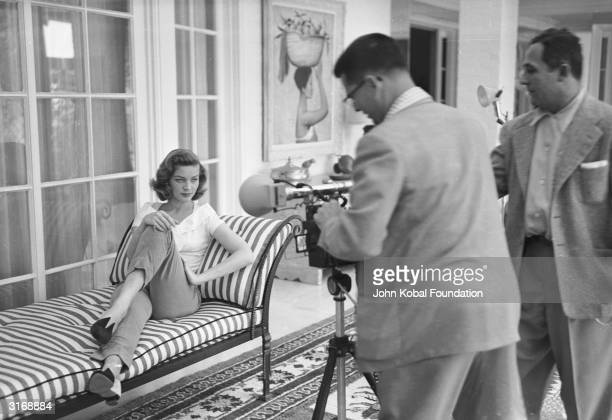 American screen star Lauren Bacall whose successful film career spans more than fifty years poses for a photographer