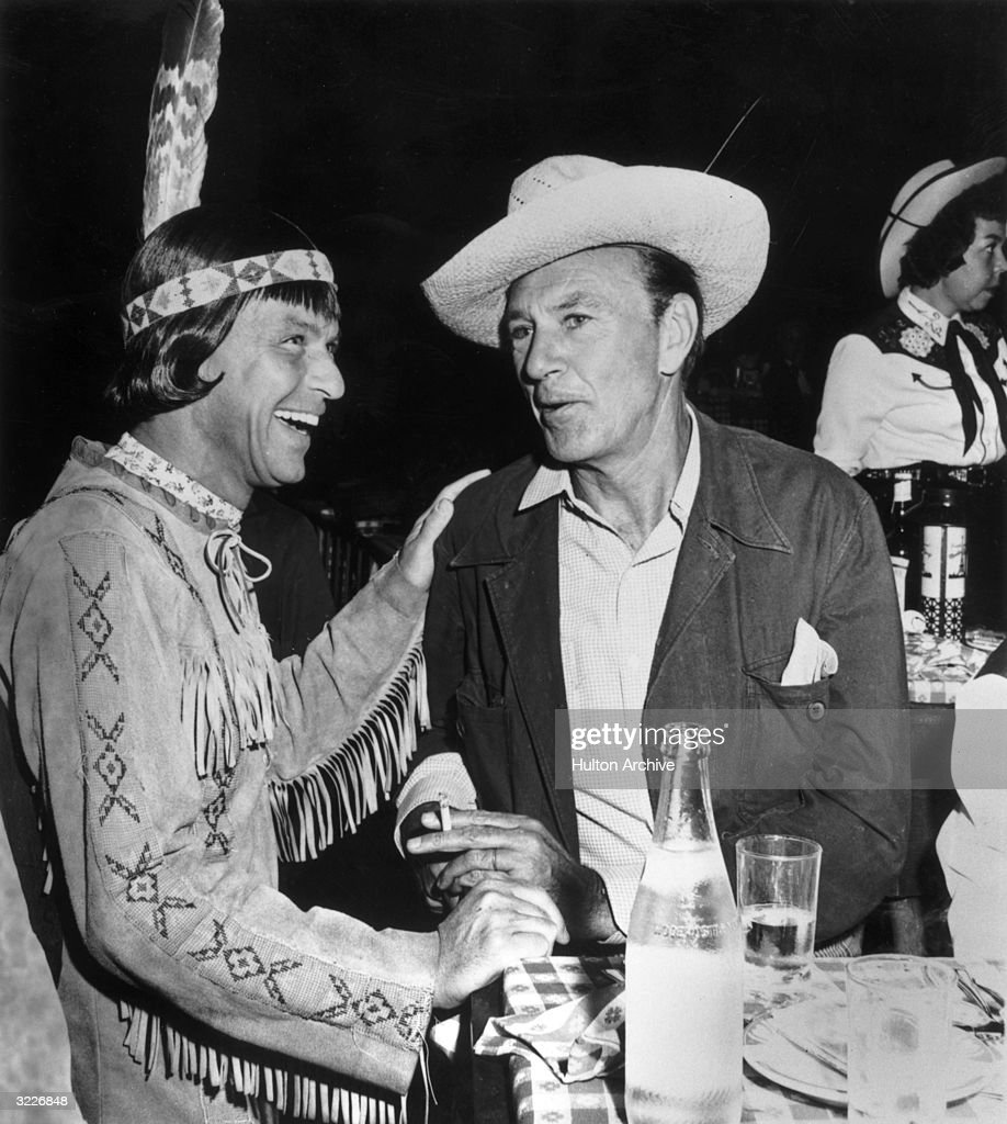 American singer and actor Frank Sinatra wears a Native American costume as he laughs with  sc 1 st  Getty Images & Frank Sinatra Pictures | Getty Images