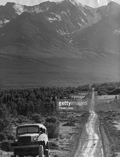 An Army truck at the side of the Alaskan Highway which US Army engineers are cutting through the Canadian and Alaskan wilderness as a vital link...