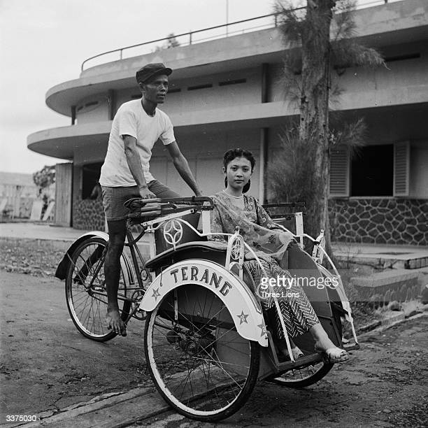 An Indonesian movie star arrives at the film studio by pedicab a pedaloperated rickshaw