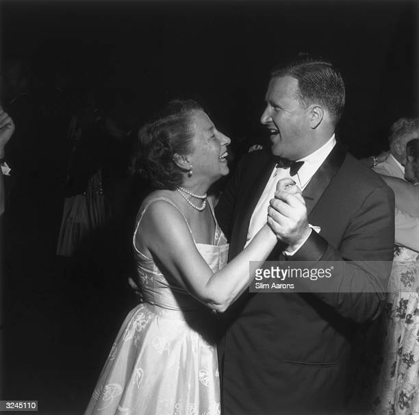 Automobile heir Henry Ford II dancing with his mother Mrs Edsel Ford at the Ford 50th anniversary party at the Ford Mansion in Palm Beach Florida