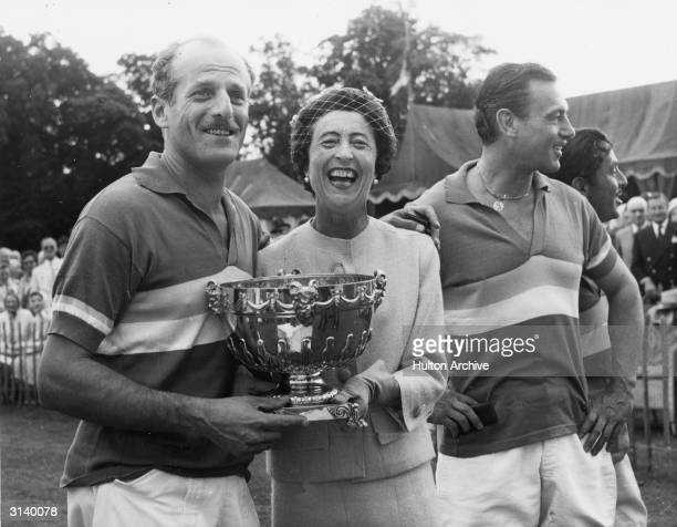 Baron Elie de Rothschild receiving the Gold Cup from the Marquessa de Santa Cruz after the final at Cowdray Park, Sussex.