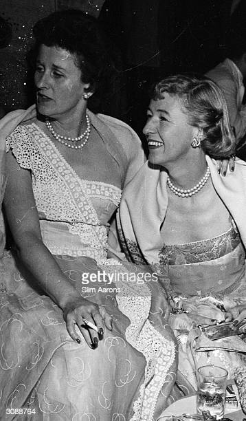 Betsey Whitney and on the right Mary Benedict Cushing at a party given by Jock Whitney A Wonderful Time Slim Aarons