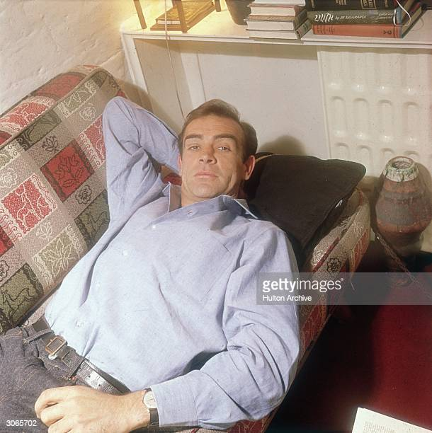 British actor Sean Connery, best known for his role in seven of the James Bond films, relaxing in his ground floor basement flat in London's NW5.