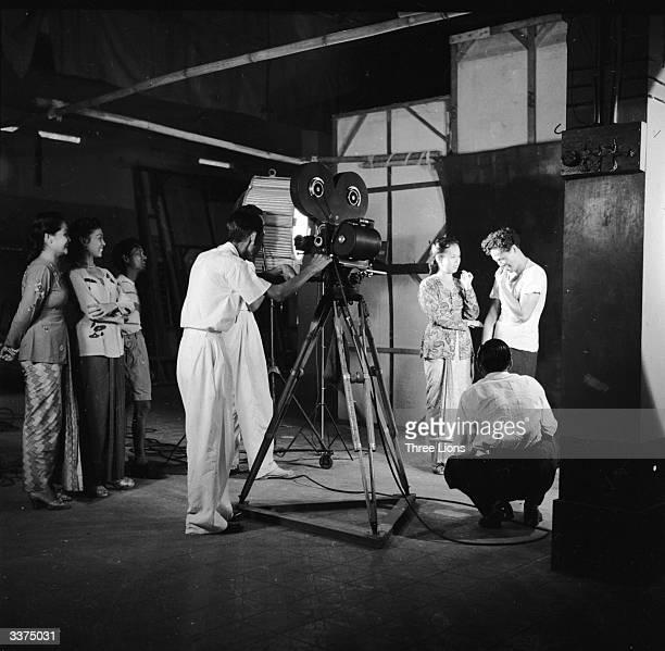 Cast and crew prepare to film the next scene in an Indonesian film studio