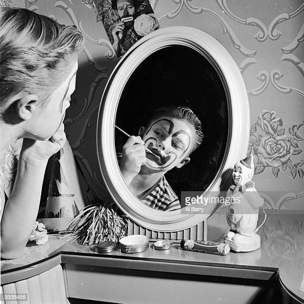 Child actor Ronnie Walken who later found fame as Hollywood star Christopher Walken painting his face with greasepaint at his home in Bayside Long...