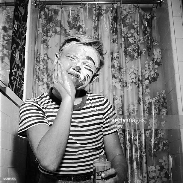 Child actor Ronnie Walken who later found fame as Hollywood star Christopher Walken taking off his clown's make up