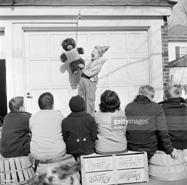 Child actor Ronnie Walken who later found fame as Hollywood star Christopher Walken puts on a show for the local kids at his home in Bayside Long...