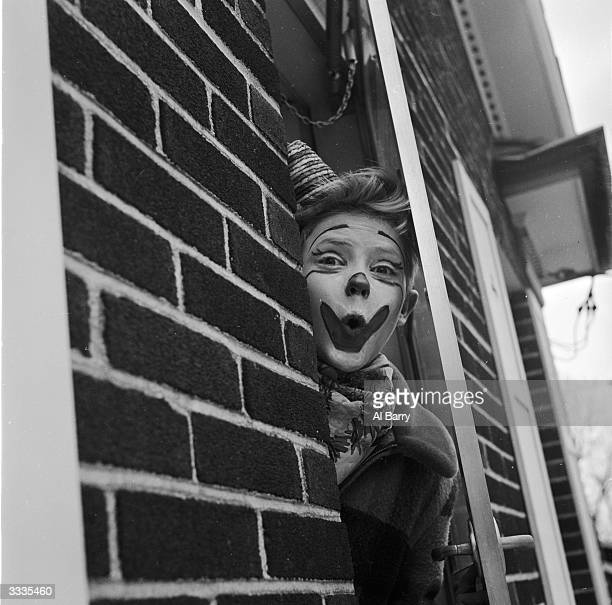 Child actor Ronnie Walken who later found fame as Hollywood star Christopher Walken wearing a clown's greasepaint at his home in Brayside Long Island