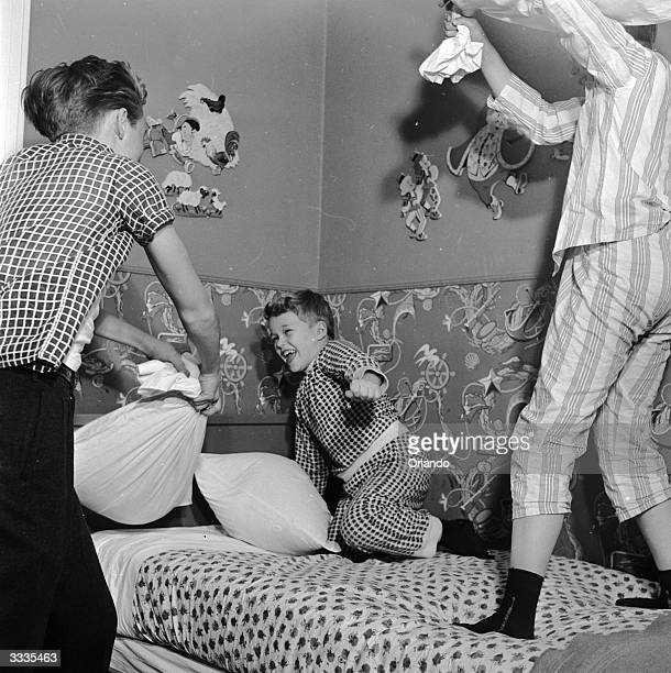 Child actor Ronnie Walken who later found fame as Hollywood star Christopher Walken enjoying a pillow fight with his brothers and fellow child stars...