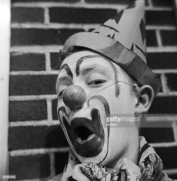 Child actor Ronnie Walken who later found fame as Hollywood star Christopher Walken pulling a face while dressed up as a clown