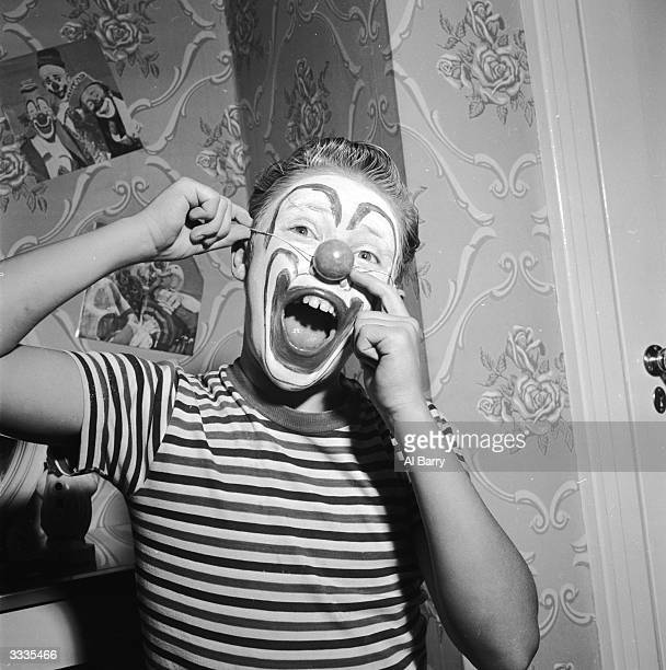 Child actor Ronnie Walken who later found fame as Hollywood star Christopher Walken wearing a clown's nose and greasepaint