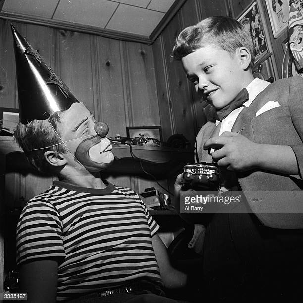 Child actor Ronnie Walken who later found fame as Hollywood star Christopher Walken mimes for his brother Glen