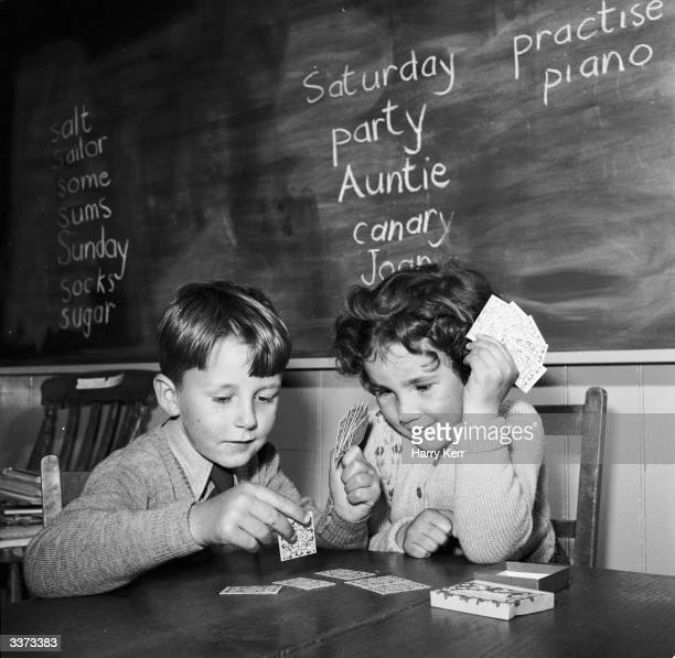 Children at the Right Ash Green Primary School near Colchester Essex learning mathematics using card games devised by their headmistress Miss Mary...