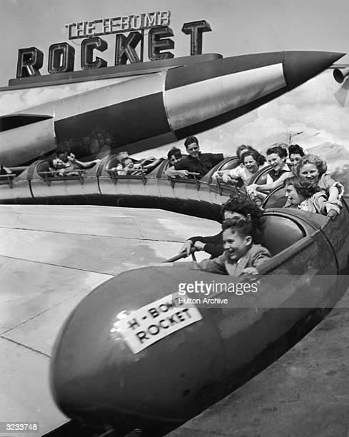 Children scream as they round a turn on the 'H-Bomb Rocket' ride at The Rockaways Playland amusement park, Rockaway Beach, Long Island, New York.