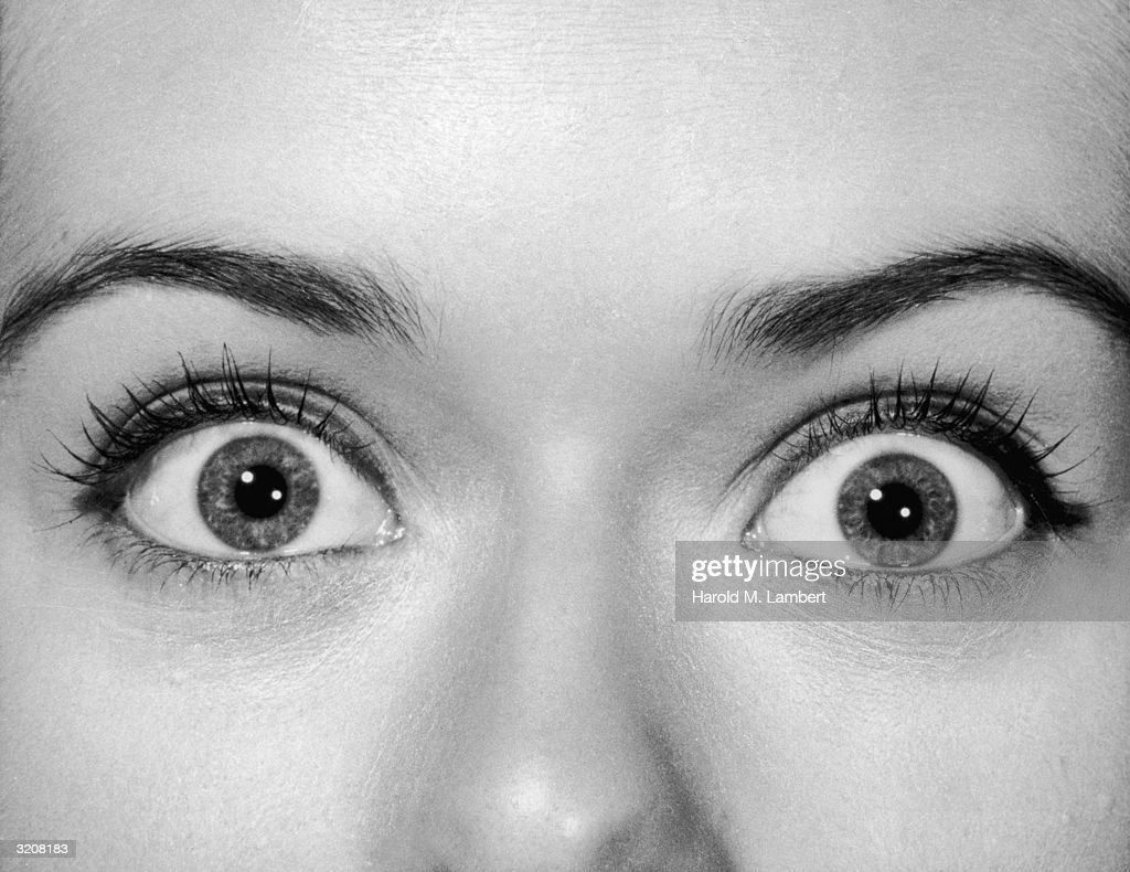 Close-up view of a woman's eyes open wide with shock, undated.