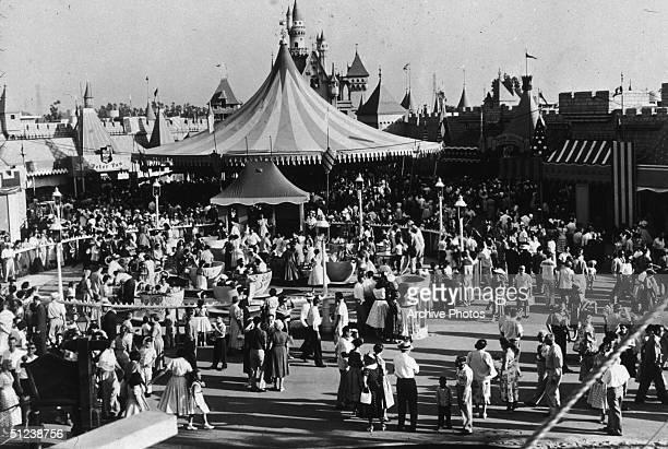 Circa 1955 Crowds walking around the Disneyland theme park in Anaheim California