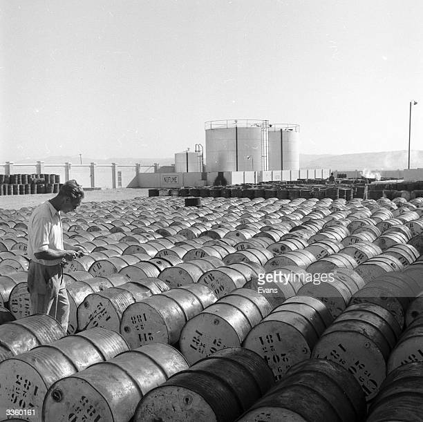 Drums of sperm oil await processing into spermaceti at a plant on the Paracas Peninsula in Peru