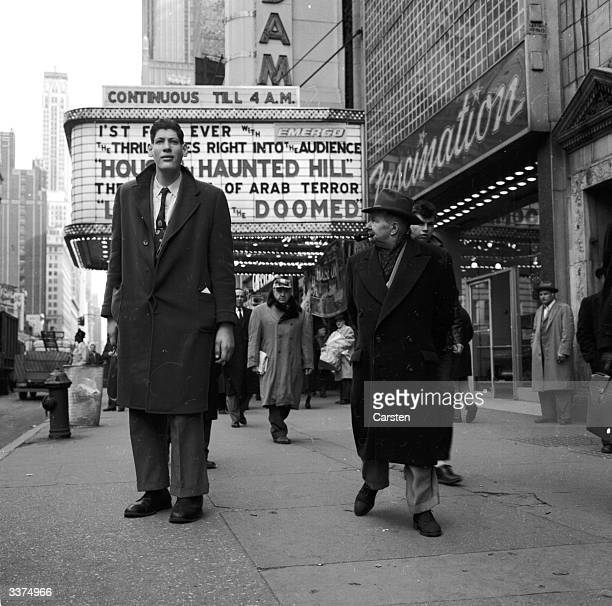 Ed Carmel known as Big Ed attracts attention from pedestrians on New York's 42nd Street as they stare at his giant proportions