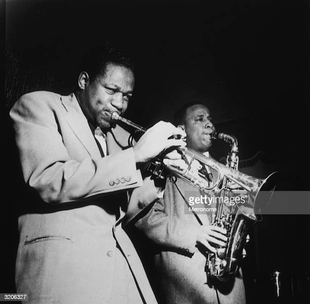 EXCLUSIVE American jazz musicians Clifford Brown and Lou Donaldson performing on stage with a trumpet and an alto saxophone respectively during a show
