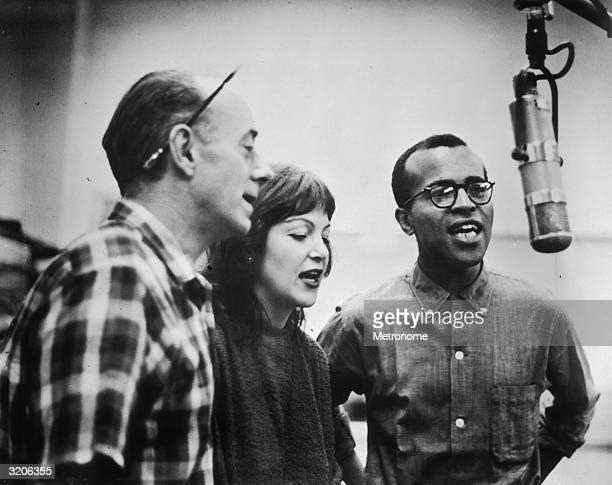 EXCLUSIVE American jazz vocal group Lambert Hendricks Ross sings into a microphone during a studio recording session LR Dave Lambert Annie Ross and...