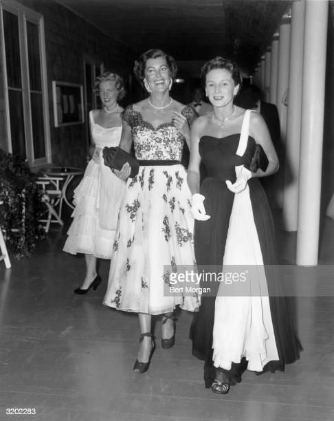 EXCLUSIVE Full length portrait of Mrs Gary Cooper and Mrs Henry Ford II in evening attire at the Meadow Club in Southampton New York