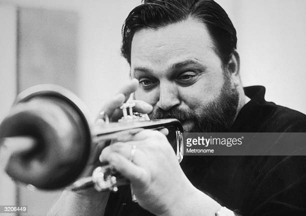 EXCLUSIVE Headshot of American jazz musician Al Hirt playing the trumpet