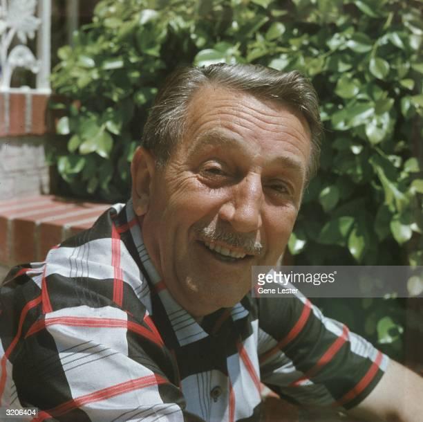 EXCLUSIVE Headshot portrait of American animator and film studio founder Walt Disney smiling outdoors