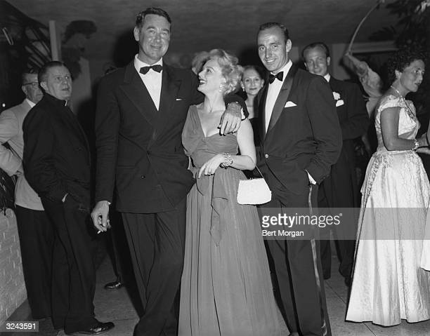 EXCLUSIVE Society photographer Slim Aarons Hungarianborn actor Eva Gabor and Philip Shell pose together at a formal event 1950s