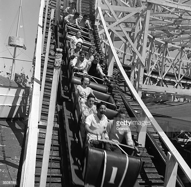 Exitement blends with terror for riders on the rollercoaster during this 65 degree descent at Palisades Park New Jersey