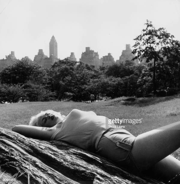 Film actress Jayne Mansfield relaxing in Central Park New York