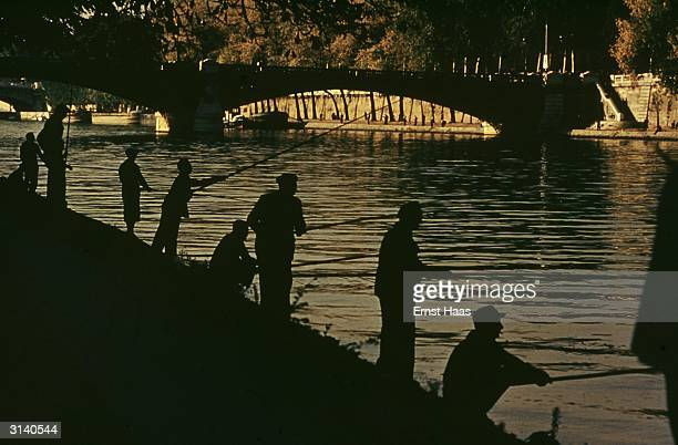 Fishermen casting their rods along the banks of the River Seine in Paris Colour Photography book