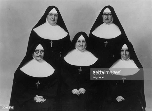 Five nuns who are all sisters L to r Sister St Denis Sister Anne of Jesus Sister Marie Xavier Standing l to r Sister Marie Daniel and Sister Marie...