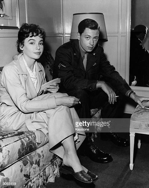 French actress Leslie Caron relaxes between takes with American actor John Kerr her costar in the upcoming movie 'Gaby'