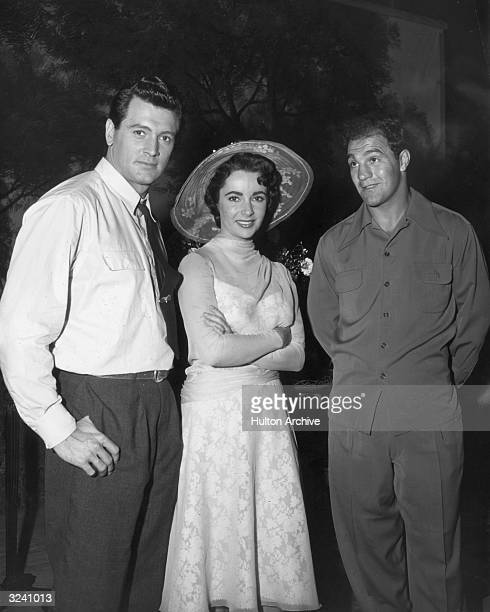 From lrft to right American actor Rock Hudson Britishborn actor Elizabeth Taylor and American prizefighter Rocky Marciano pose on the set of director...