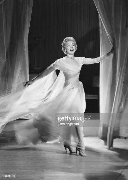 German-born actress Marlene Dietrich wearing a flowing gauzy dress.